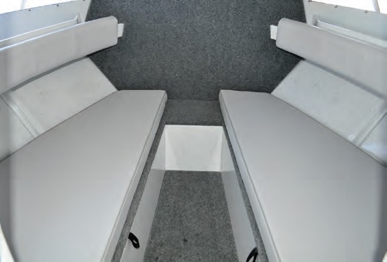The cabin bunks provide plenty of sleeping room and storage.