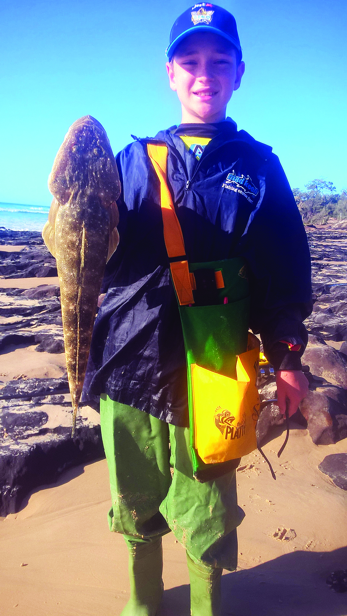 The author's son with a lovely 60cm flatty from the surf.