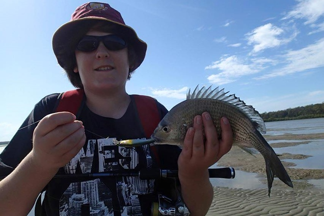 Tin Can Bay crewy Craig and his offsider Austin walked the flats at tools down for this flatty and bream.