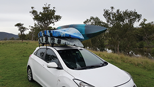 Three kayaks on a small hatchback. The J rack makes it easy.