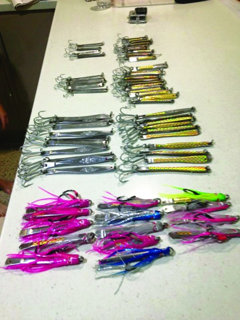 A stash of metal lures made from stainless butter knives and ready for testing.