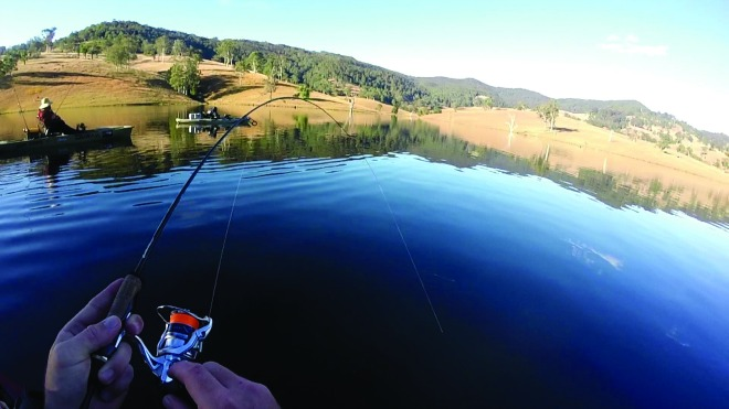 The author hooked up to a solid bass by vertical jigging soft plastics.