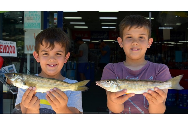 Jake and Bayley Scott-Holland with a couple of 30cm whiting they caught near the Noosa Yacht Club on Sunday. Photo: www.fishingnoosa.com.au