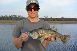 Annette Montebello scored a bass from the edge on a lipless crank.