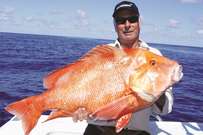 Battling the current to boat big red fish