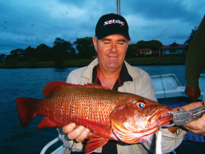 Terry Finch with a quality fish caught while trolling at the start of the fruit bat period.