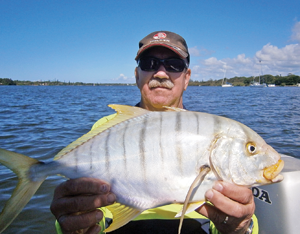This beautifully marked golden trevally smashed a small Pontoon21 lure trolled around a bait school.