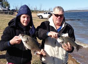 Jackson and Ross Tinney with their bass haul.