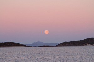 The full moon was setting as the sun was rising over Great Keppel Island.