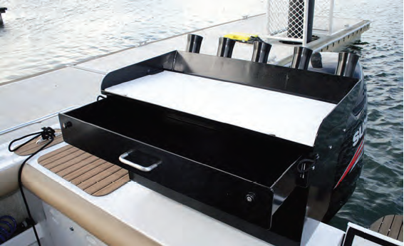 The bait board with attached rod holders and large storage drawer.