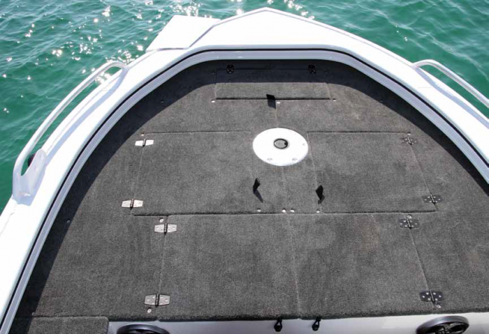 Massive front casting deck with storage hatches, anchor hatch and live well.