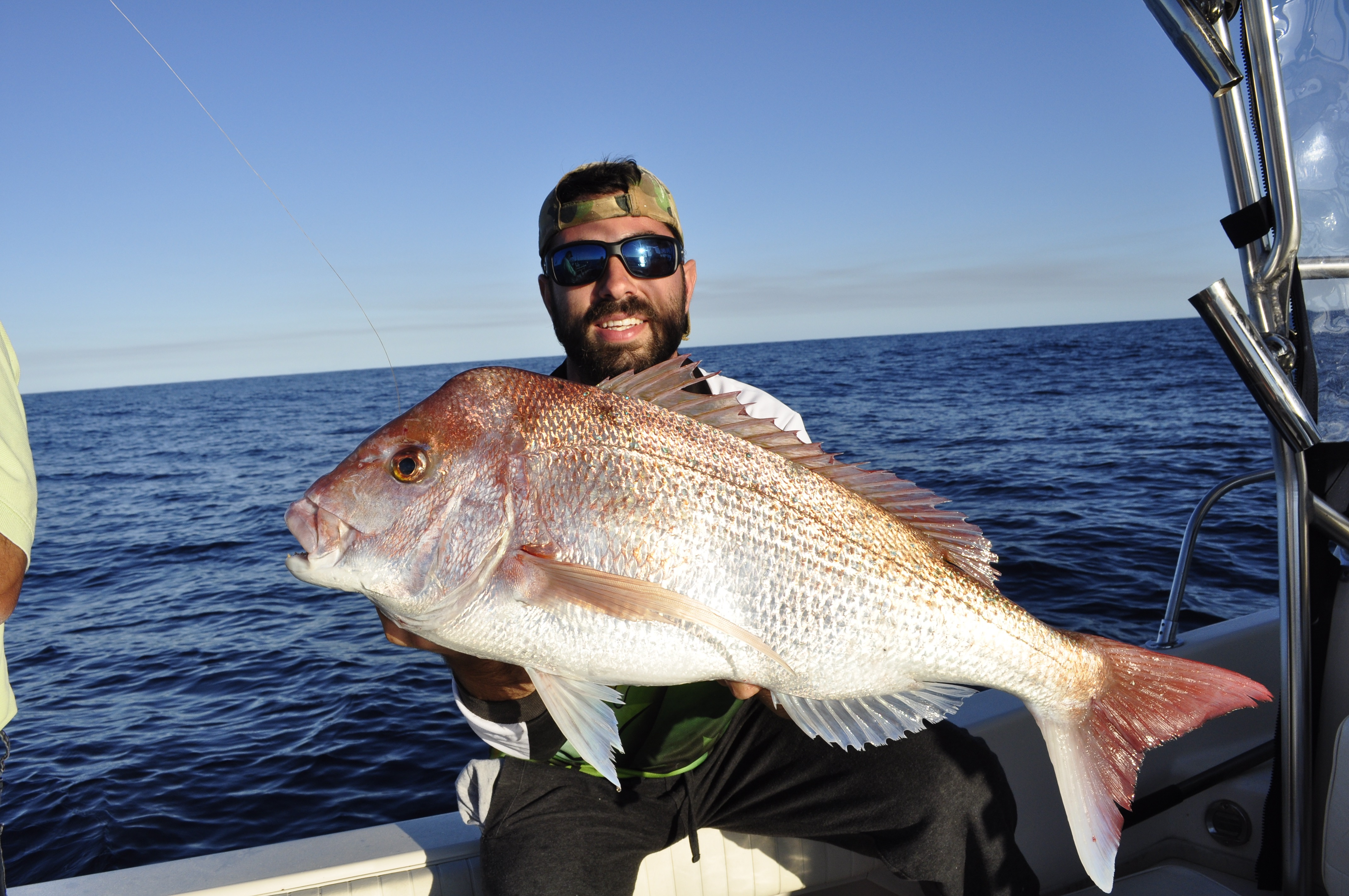 Peter with a quality snapper that fell to a float line rig.