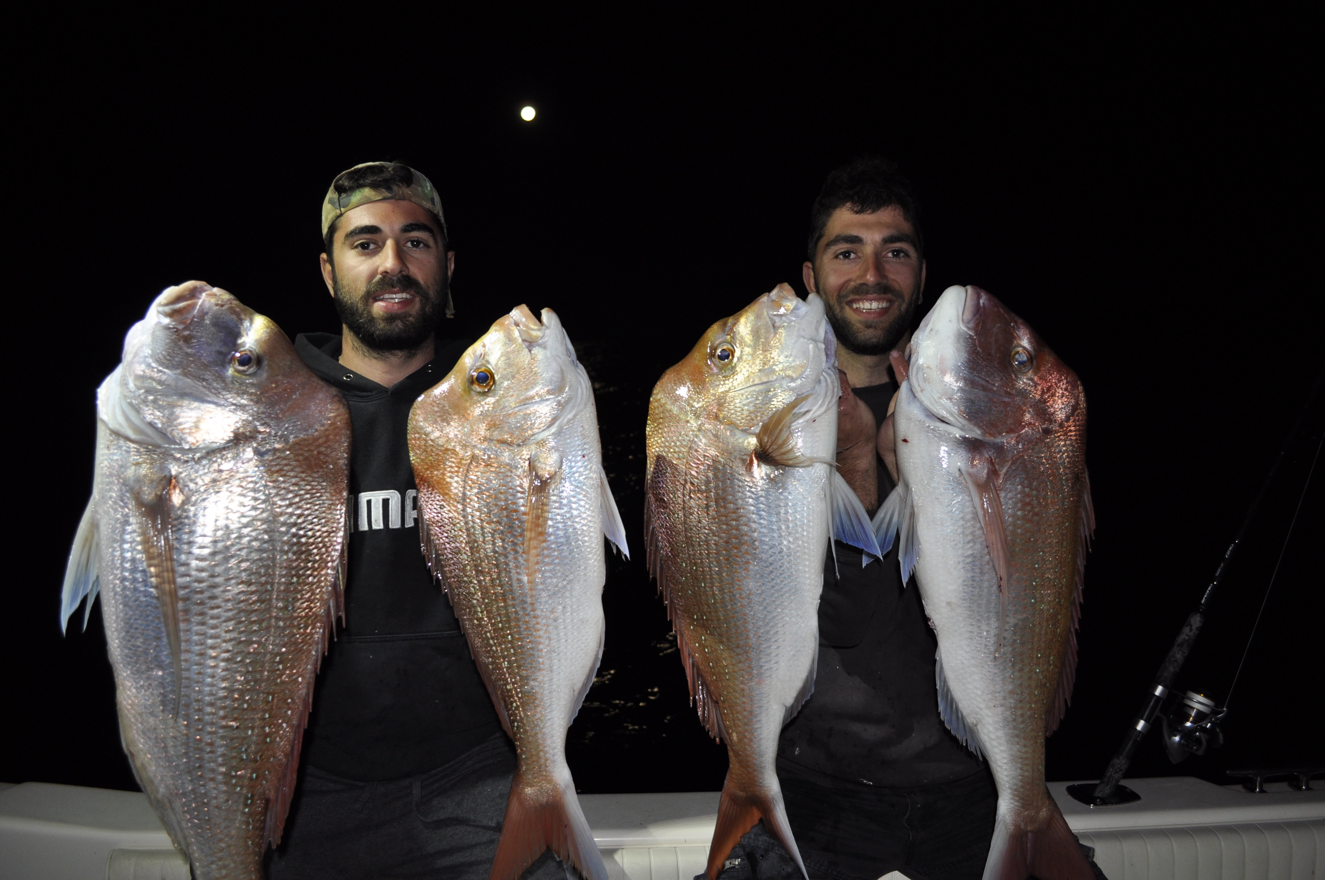 Peter and Angelo showed off some quality snapper hooked on a recent full-moon trip to the Banks.