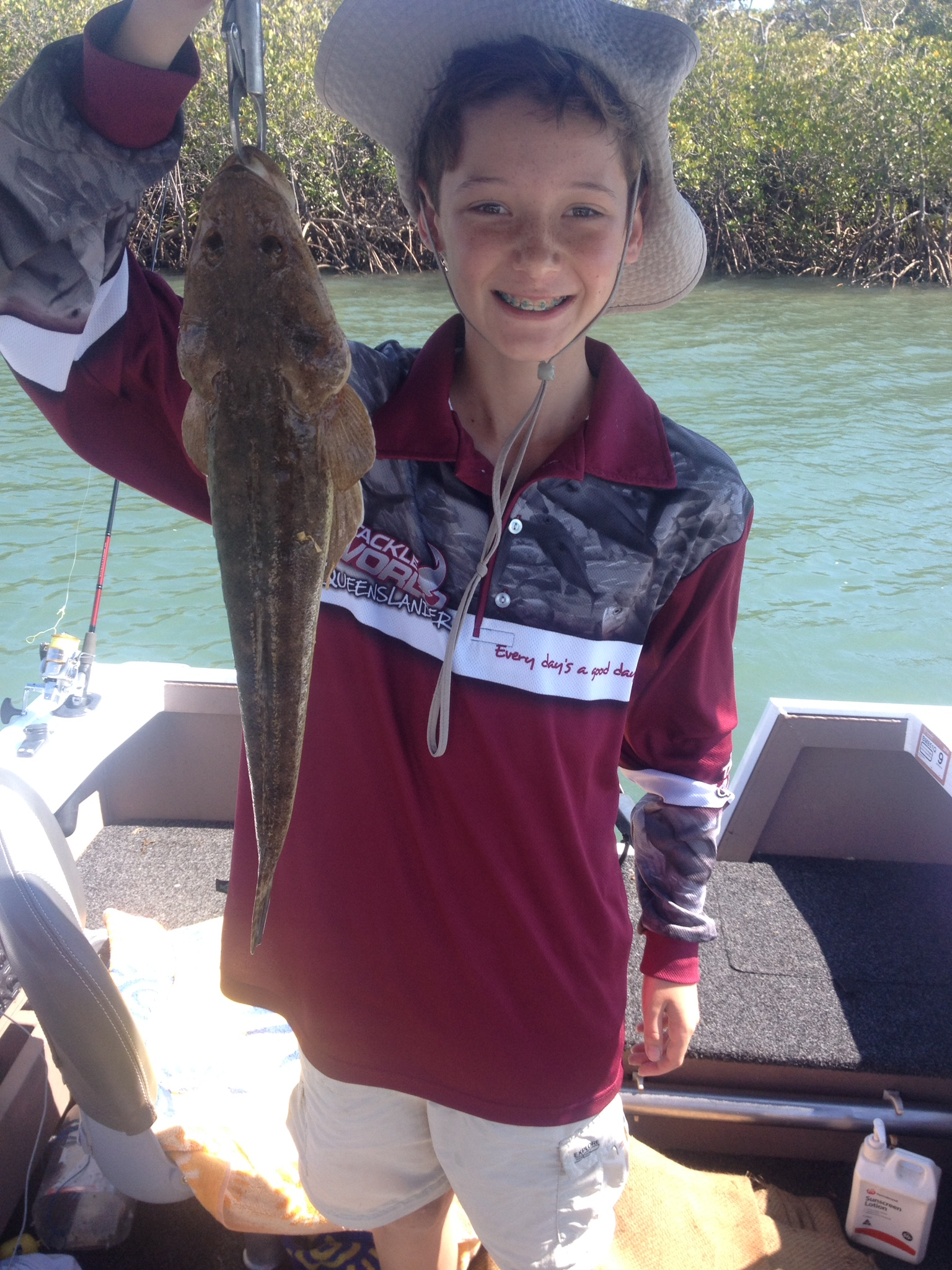 Young William Stupart with the nice flathead he caught in the Kolan River recently.