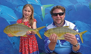 Aroha and Matthew Ray caught these golden trevally near the Gympie Terrace boat ramp. Photo: noosafishing.com.au