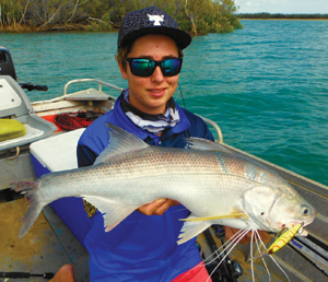A cracking threadfin salmon taken while casting lures along a snaggy bank.