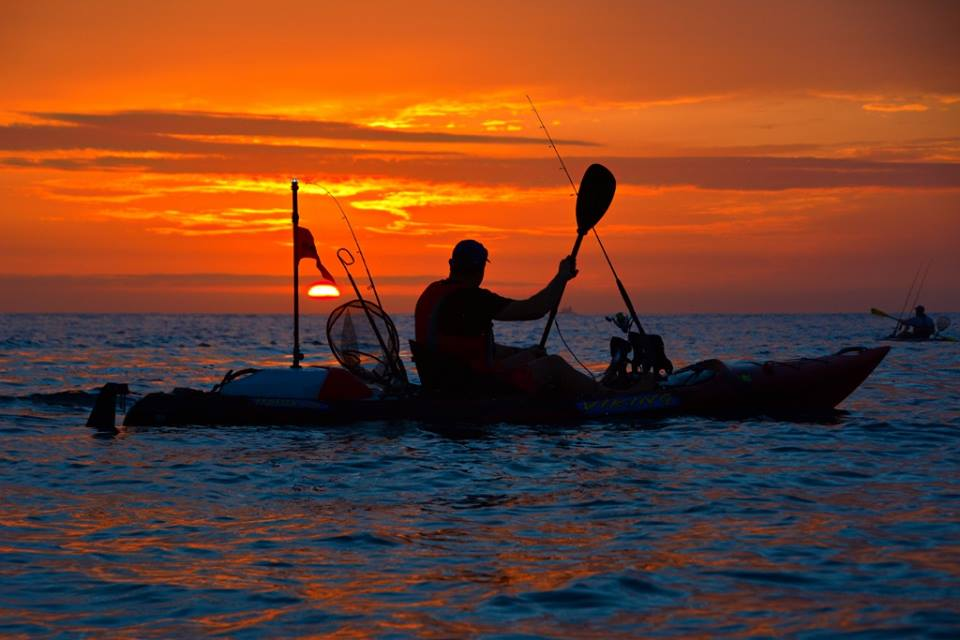Sunrise made for a stunning backdrop as the author and co paddled out for a day's fishing.