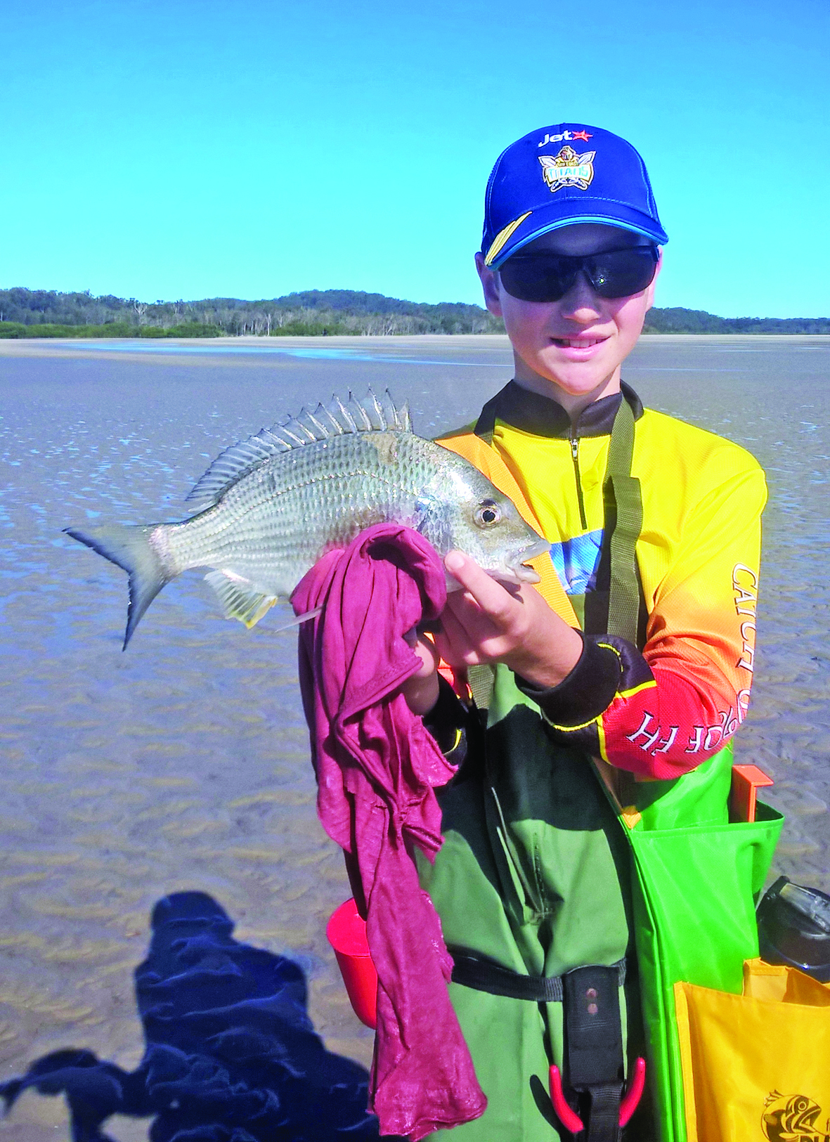 The author's son with a bream from Fraser's flats.