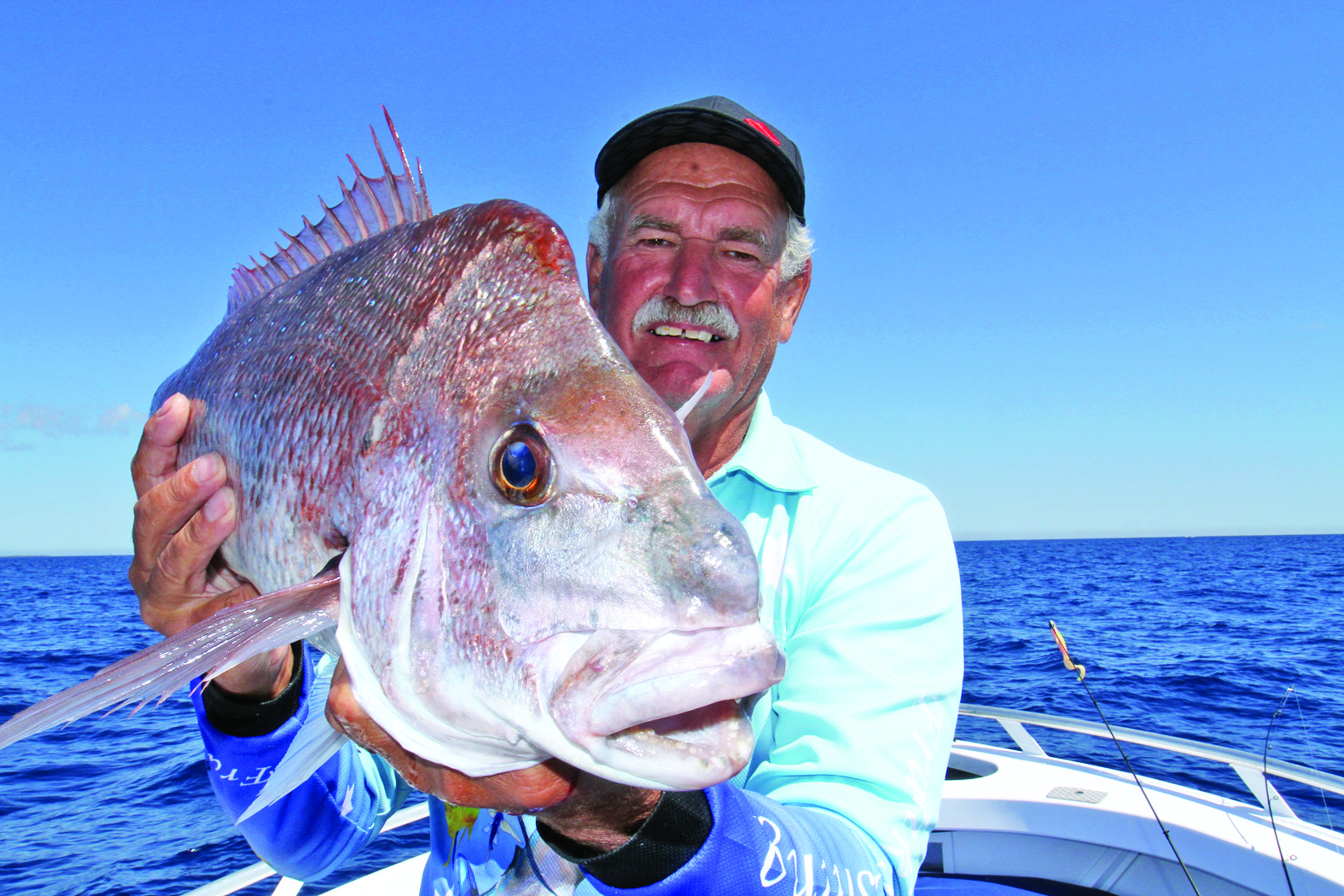 A snapper caught on a 5'' Berkley Gulp in Pink Shine from his new Stessl.