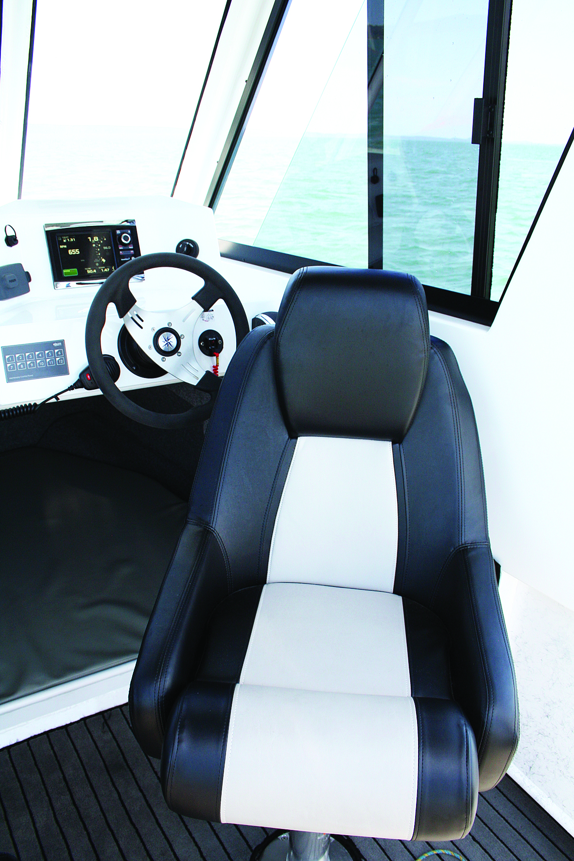 A hard top gives you such a great sense of security when at the helm and punching through a sloppy sea.