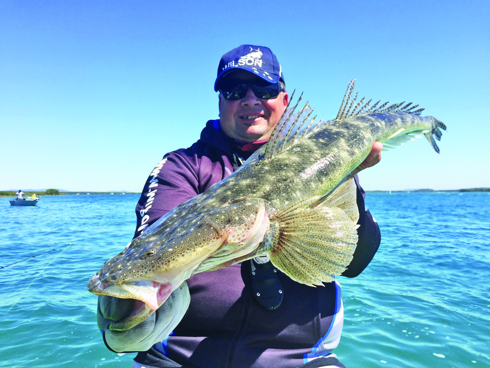 Troy with a cracker flathead caught in 9m of water.