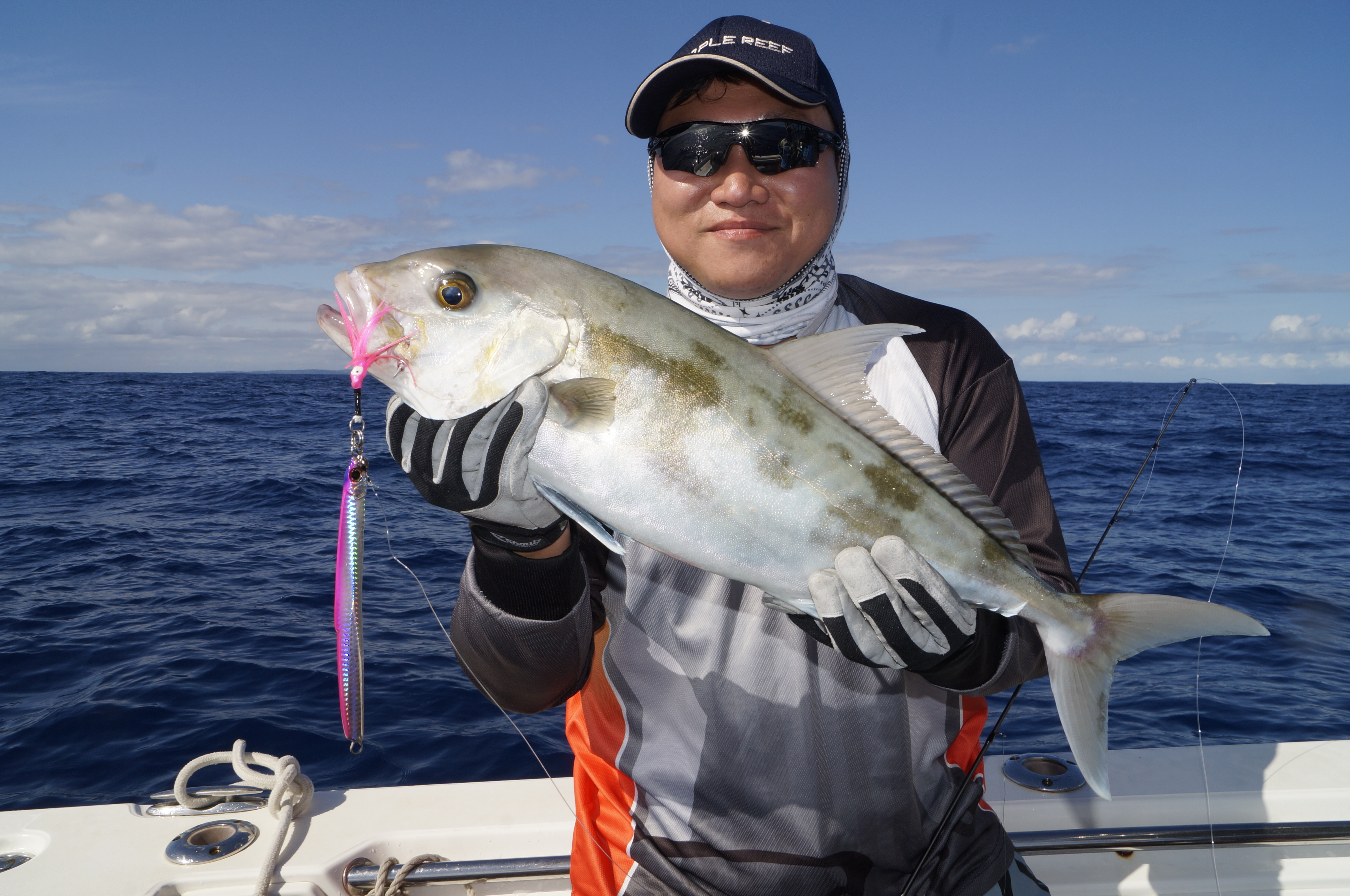 Glenn Han with a typical ambo jigged around a tightly packed bait school.
