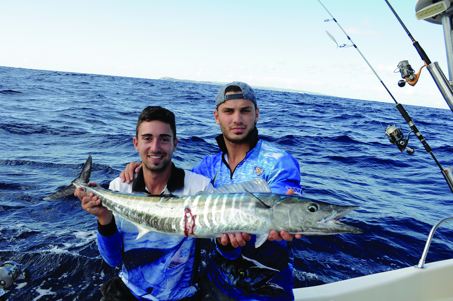 Mati and Pana with a little wahoo that fell to a metal slug off Moreton Island.