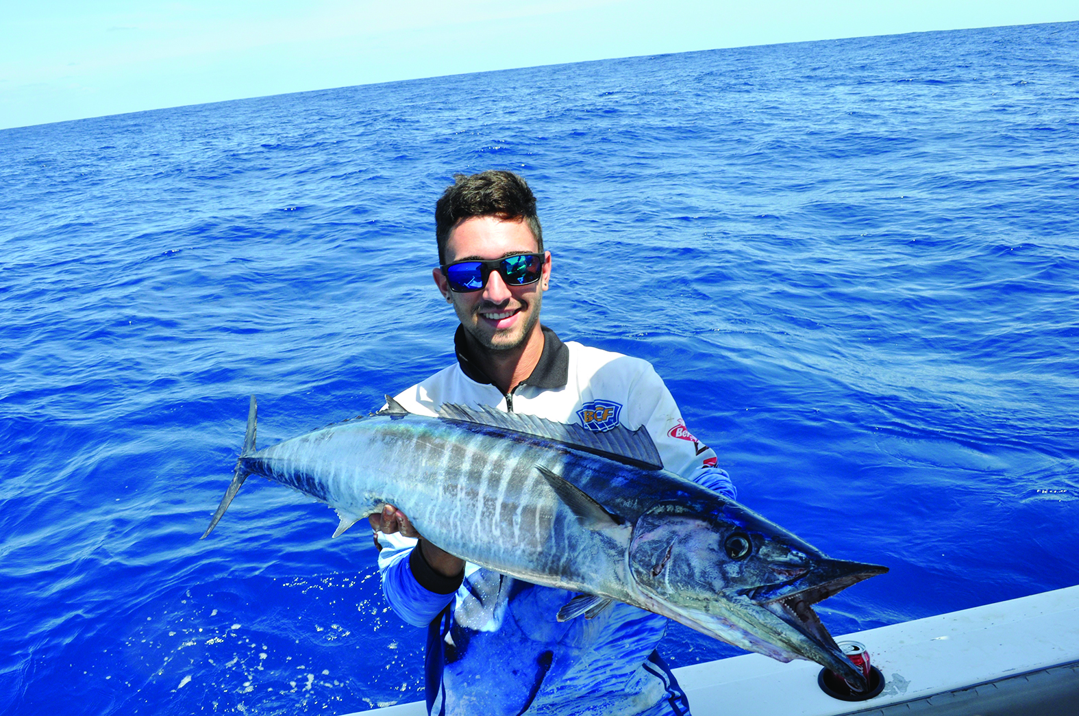 The author shows off a wahoo landed off Stradbroke Island by trolling hex heads at 12 knots.