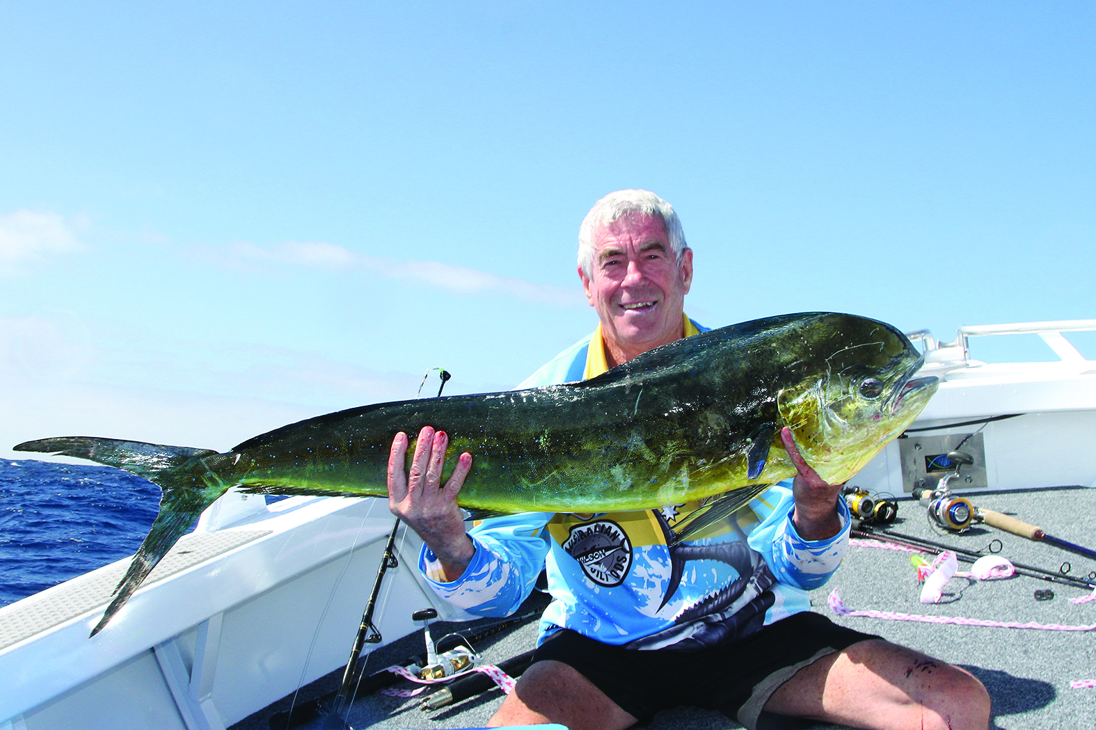 Ron Winnet with a dolphin fish caught in sloppy conditions.