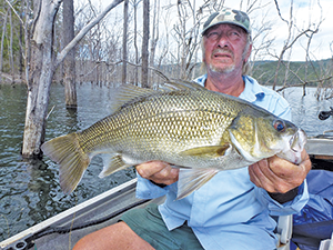 A live shrimp fished in the dead trees at Hinze Dam was the secret to Wayne landing this great bass.