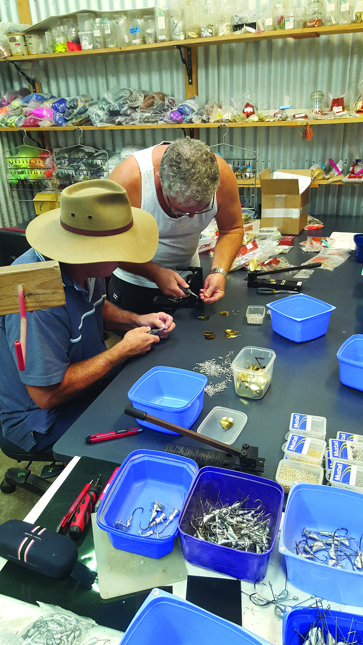 Glen of Bassman Spinnerbaits and an employee putting blades on jig heads.