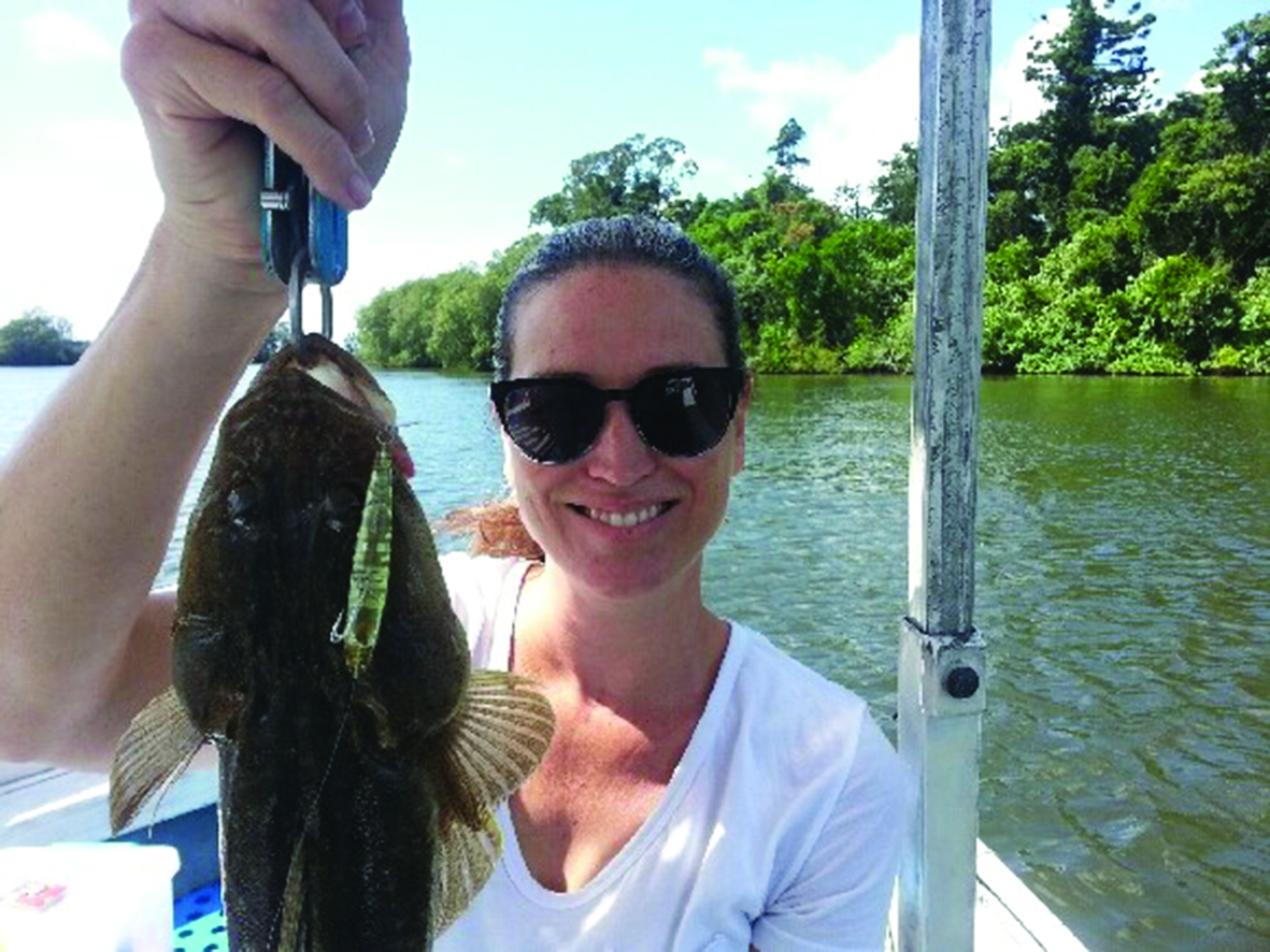The mud exploded when this flathead rose to the top to hit Courtney's Bassday Sugapen surface lure.