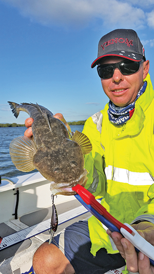 Colin with a flathead taken on a trolled Zerek Tango Shad around Jumpinpin.