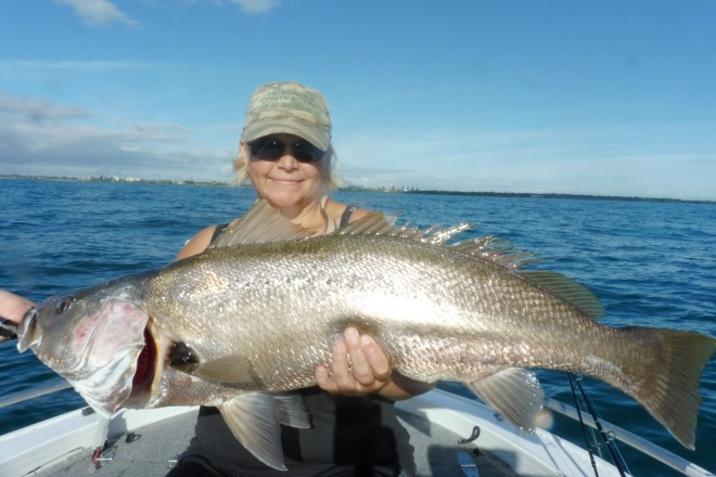 Cindy Meissner with a jew she caught off Burnett Heads on her first ever attempt at micro-jigging.