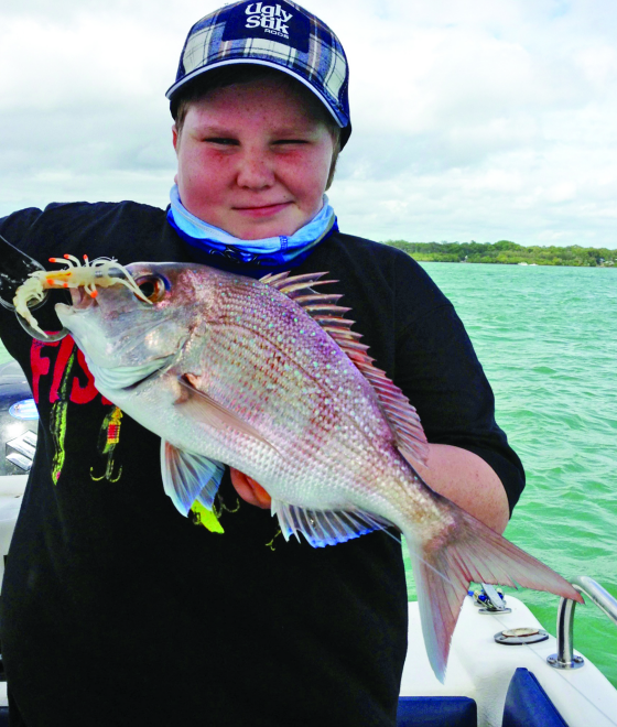 Hayden with a pan size snapper enticed by a Zerek Live Shrimp Hot Legs.