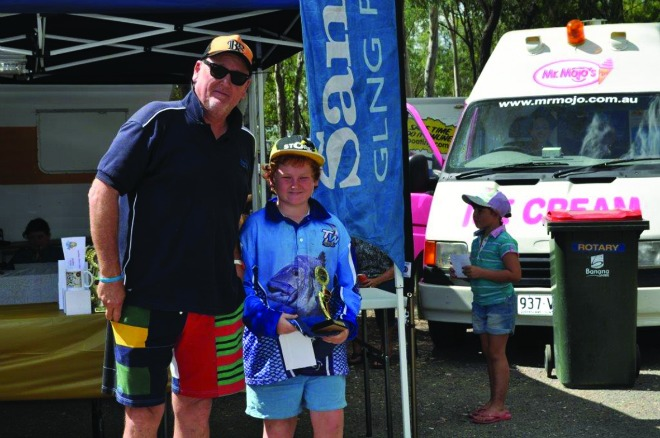 Santos representative Dean Salter presented Milton McGeachin with his prize for catching the biggest saratoga taken by a junior.