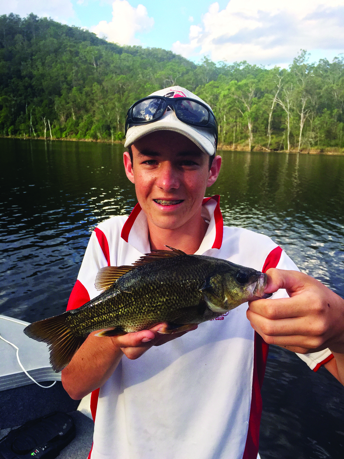 Ryan with a 33cm bass hooked on a brown curly tail from Softplasticsdude.