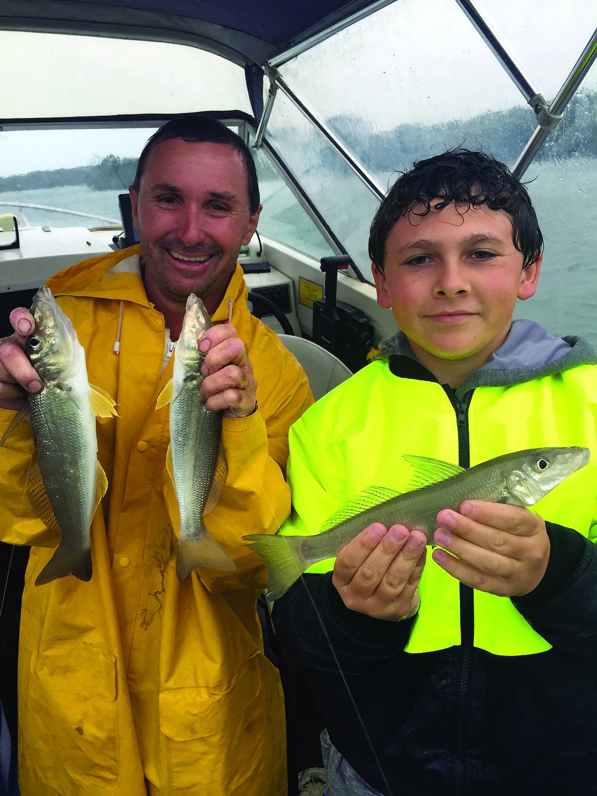 Cade Luckus and the author displayed a couple of whiting caught in atrocious conditions.