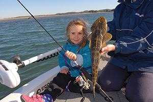 Selina looked pleased as punch with her first flathead caught by herself.