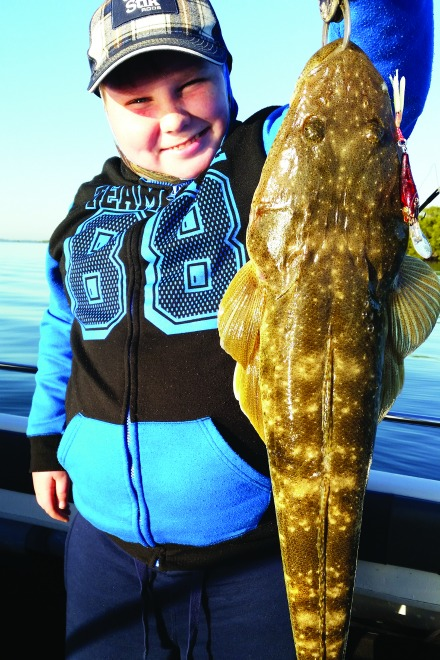 Hayden scored his PB 63cm flathead on a trolled hard-body.