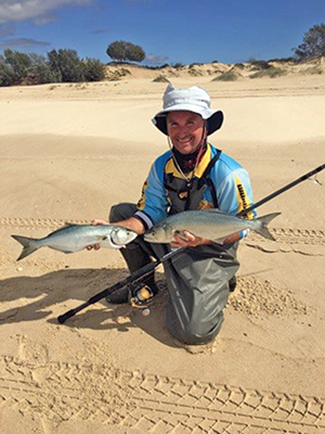Waders are a must in winter. The author showed off a couple of the average-sized fish turning up on the beaches.