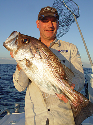 Macca and a 63cm pearl perch hooked 30km from the Wide Bay Bar using light line and a pilchard for bait.