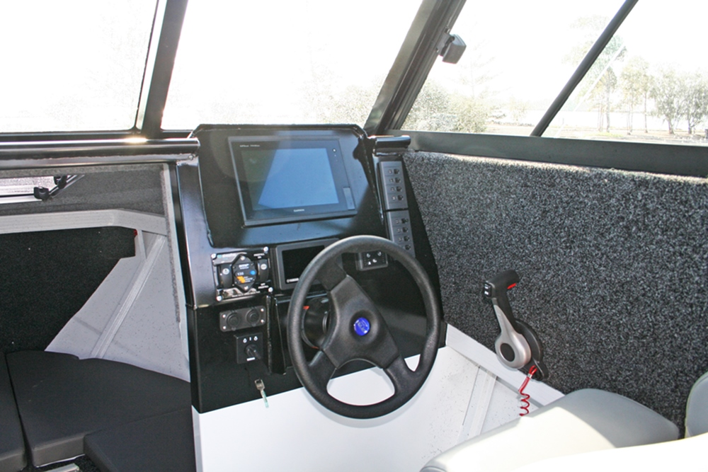 The helm is an accommodating place to be, with masses of space for electronics and a good driving position. Vision is excellent thanks to the expansive windscreen.