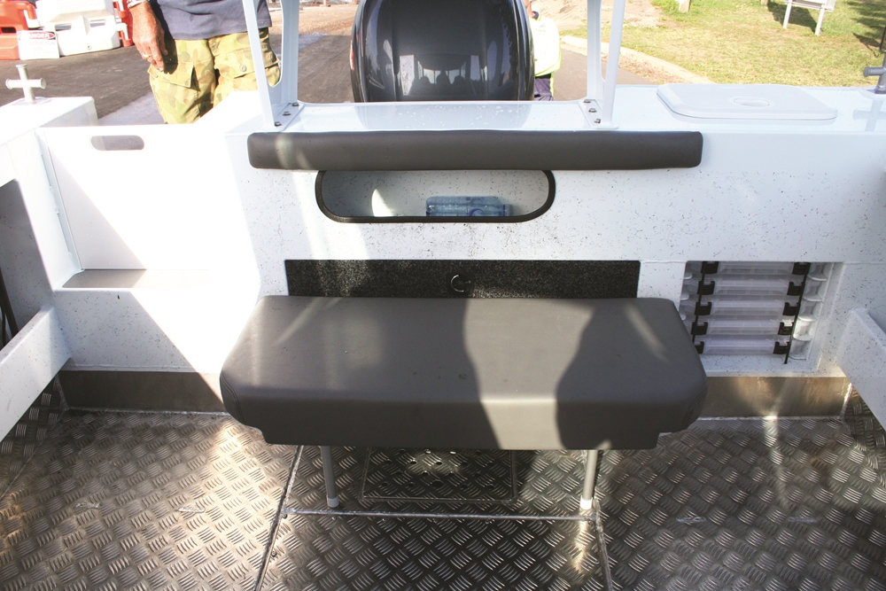 Storage abounds on the 630 HT, even at the transom. Custom-designed Plano tackle storage solutions a neat touch.
