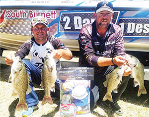 The author and dam manager Corey with a brace of bass that saw them place fourth in a recent teams tournament at Boondooma.