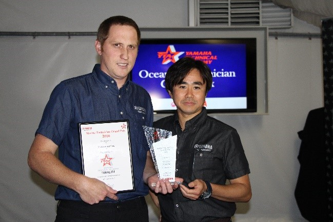 Mathew receives his award from Mr Mike Endo Director Yamaha Motor Australia.